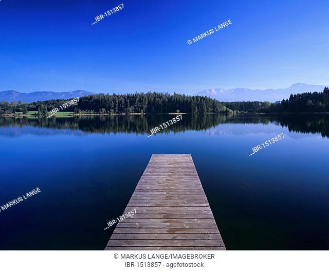 Jetty on Forggeensee lake overlooking the Alps, Ostallgaeu district, Allgaeu, Bavaria, Germany, Europe
