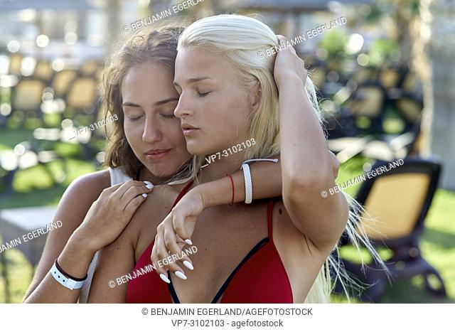 women at holiday resort, embracing, sensual, togetherness, best friends enjoying summer