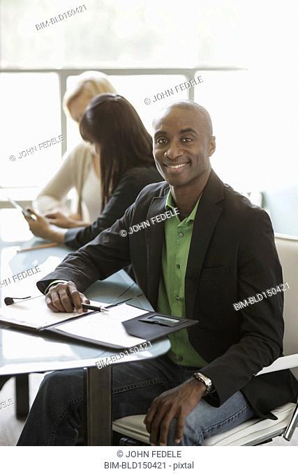 Black businessman smiling in meeting