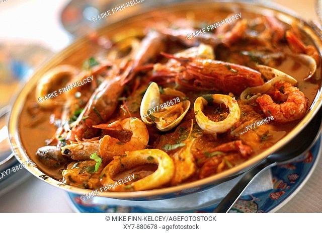 A traditional Cataplana meal at Os Salgados restaurant on Praia Dos Salgados Salgados Beach in the Algarve, Portugal PROPERTY RELEASE AVAILABLE