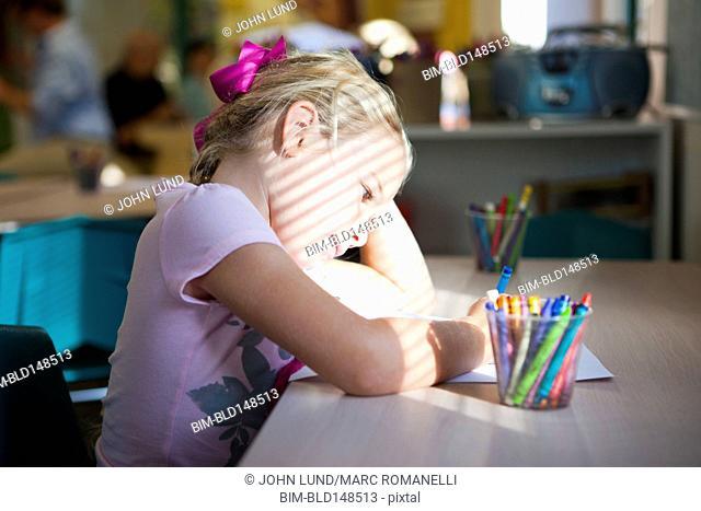 Caucasian girl coloring