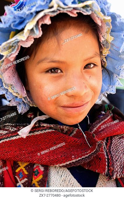 Sacred Valley, Pisac, Peru. Young girl dressed in traditional costume in Pisac Sunday market day. Pisac. Sacred Valley. Pisac, or Pisaq in Quechua