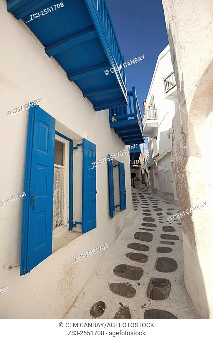 Whitewashed houses with colorful balconies and windows in the alleys of town, Mykonos, Cyclades Islands, Greek Islands, Greece, Europe