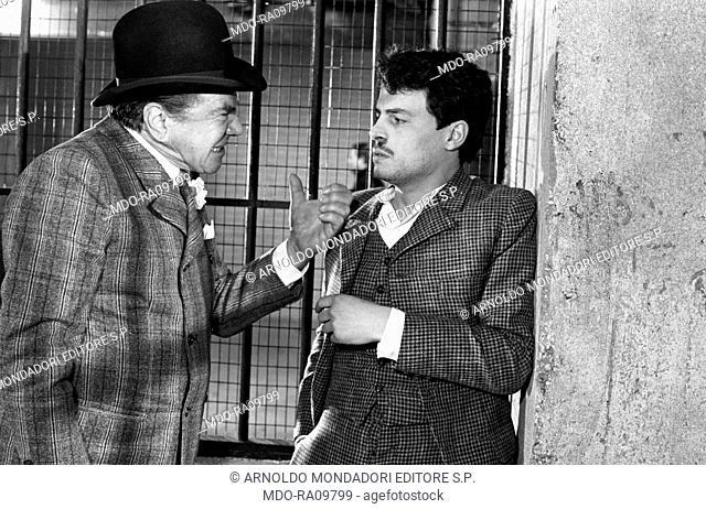 American actor Lionel Stander, as lieutenant Joe Petrosino, questioning Italian actor Michele Placido in The Black Hand. 1973