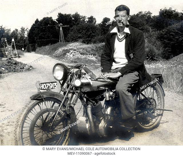 Stylish young man sitting on his 'Special' vintage modified motorcycle in the early 1930s