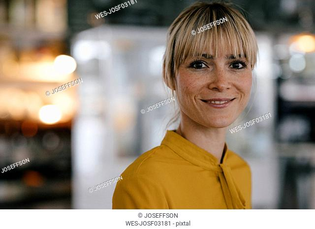 Portrait of a beautiful blond woman, smiling