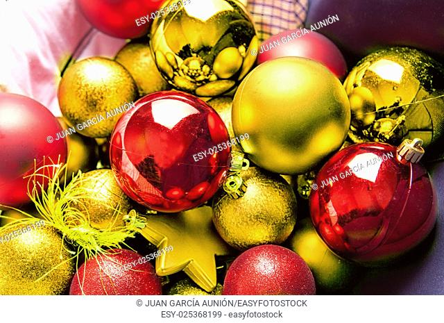Selection of red and yellow Christmas balls and stars for tree decoration