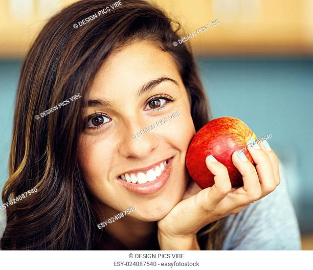 Portrait of attractive woman with an apple