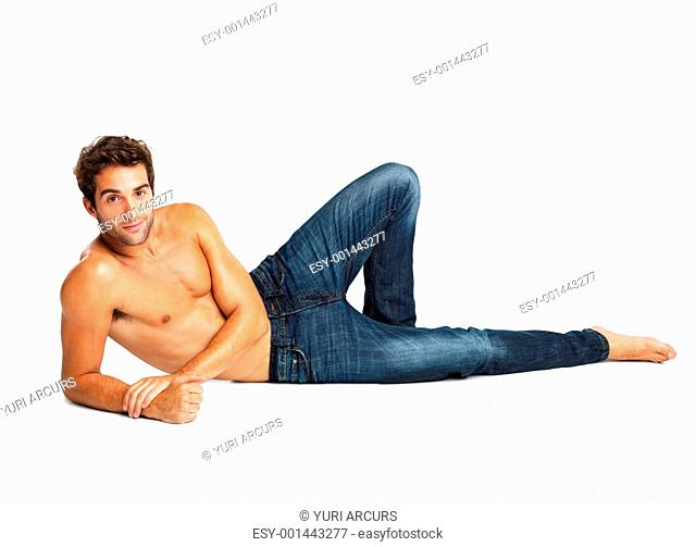 Shirtless man relaxing in blue jeans isolated on white background