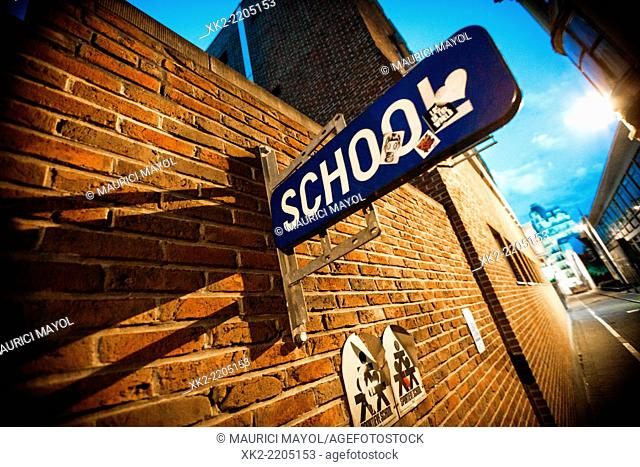 School sign attached to brickwall, Center of Antwerp, Belgium