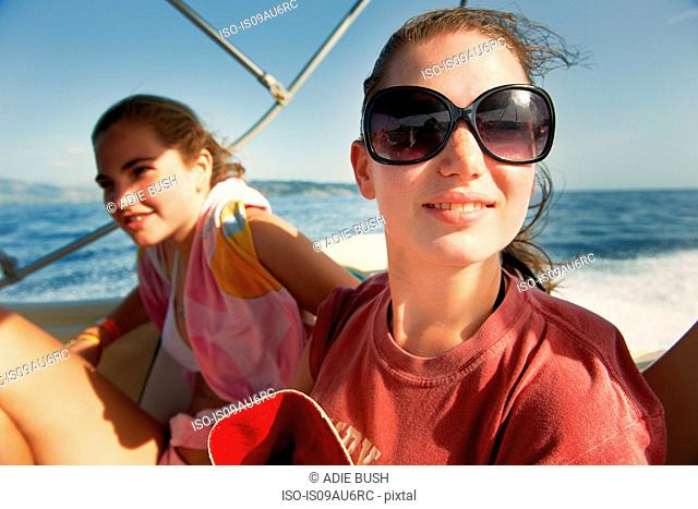 Two teenage girls on boat at sea