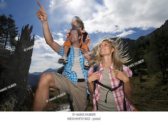 Austria, Salzburger Land, couple with son 8-9 hiking