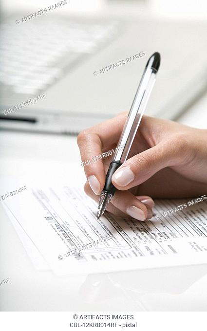Woman filling out a tax form