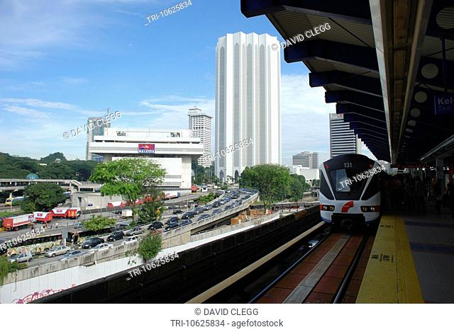 The Main Post Office and a train at Pasar Seni LRT Light Rail Transit station Kuala Lumpur Selangor Malaysia