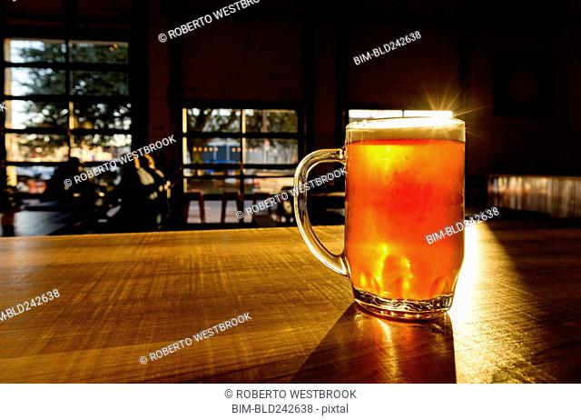 Glass of beer on counter