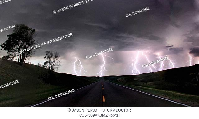 A composite image from 5 images of cloud-to-ground lightening bolts at the end of a rural road, Lexington, Nebraska, USA