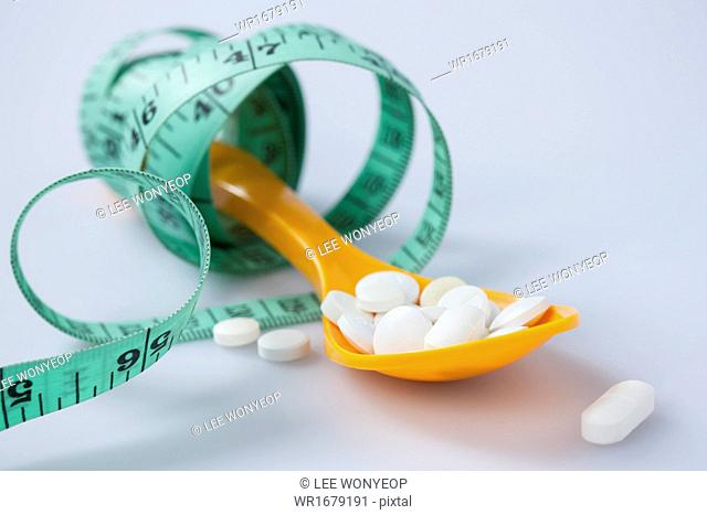 a spoon full of pills