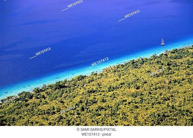 Lush coast and blue waters of the sea surrounding Mosso Island, Vanuatu