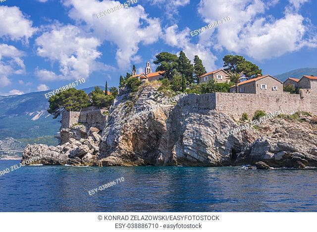 Buildings of Sveti Stefan islet and five star Aman Sveti Stefan hotel resort on the Adriatic coast of Montenegro