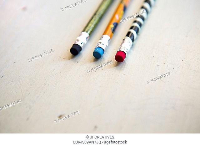 Three colouring pencils, close up