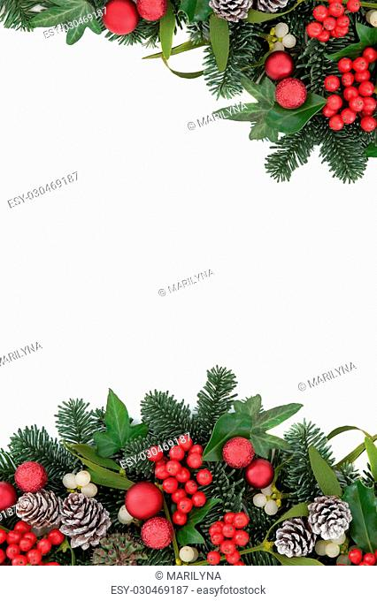 d3080a274305 Christmas background border with red bauble decorations, holly, ivy,  mistletoe, snow covered