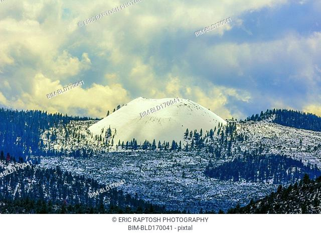 Snowy mountains under clouds