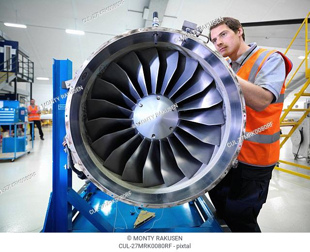 Engineer works on jet engine