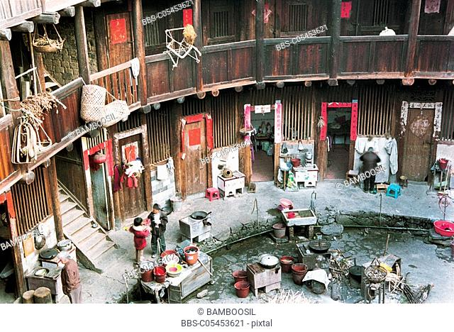 Family living in Viviparus Pit Earth Building, Zhangpu County, Fujian Province of People's Republic of China