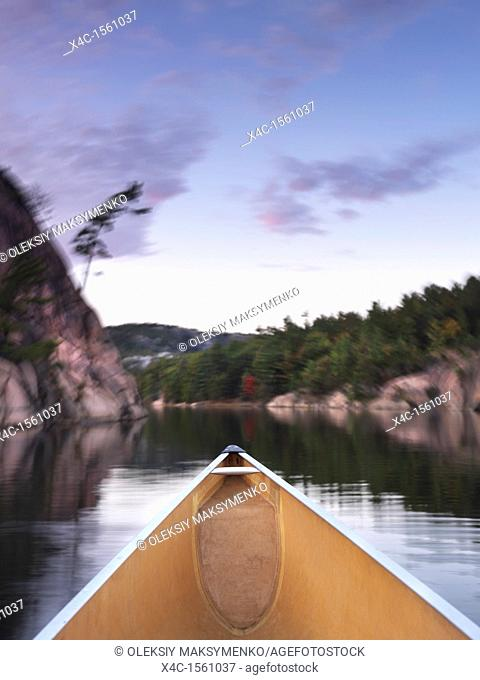 Canoeing on lake George in fall  Killarney Provincial Park, Ontario, Canada