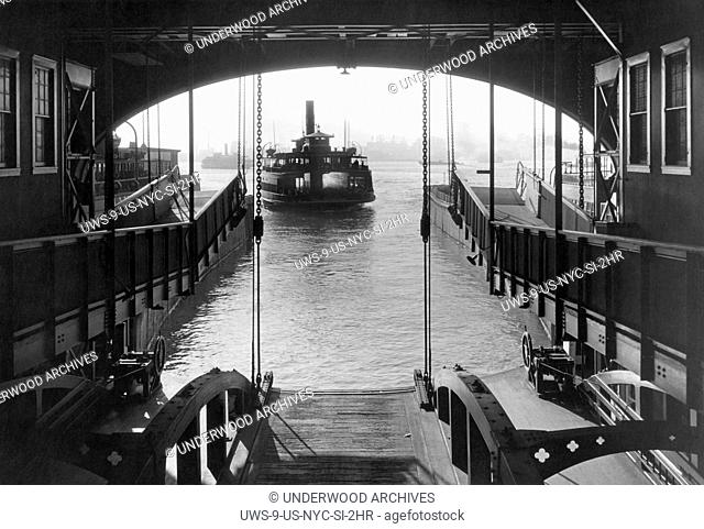 New York, New York: c. 1931.The Staten Island Ferry coming into its slip