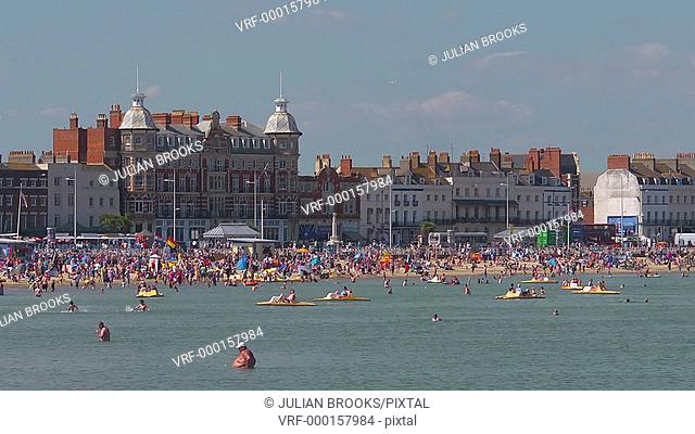 Weymouth beach at the height of summer - Royal Hotel in b/g