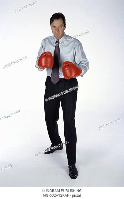 Portrait of a man wearing boxing gloves
