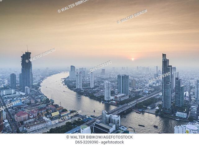 Thailand, Bangkok, Riverside Area, high angle city skyline by Chao Phraya River, dusk