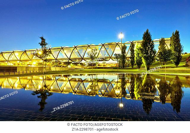 The sun sets over the Arganzuela bridge, designed by architect Dominique Perrault. Madrid Rio Park. Madrid. Spain