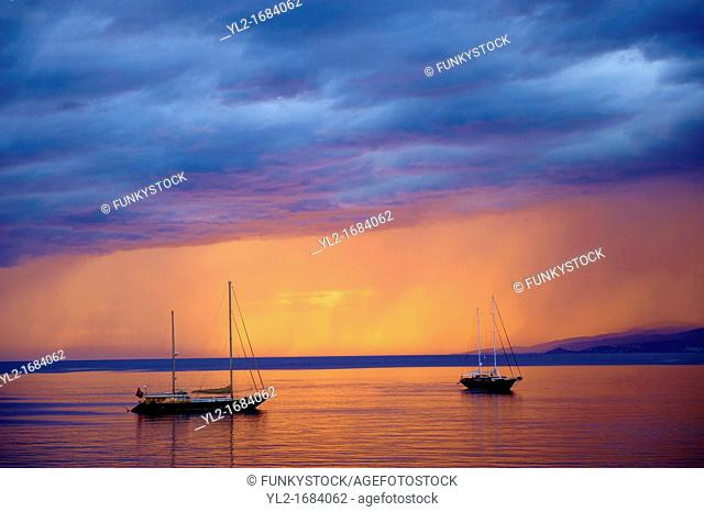 Sailing boats at sunset off Mykonos, Cyclades Isalnd, Greece
