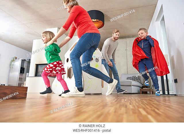 Happy family running in living room