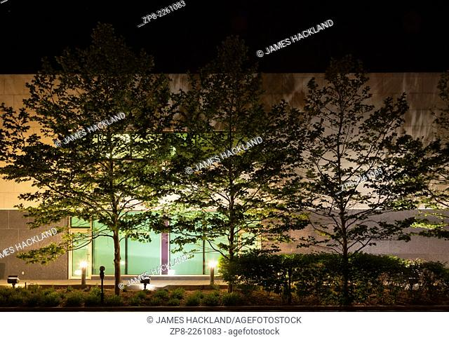 A detail shot at night of the Whitby Public Library in Whitby, Ontario, Canada
