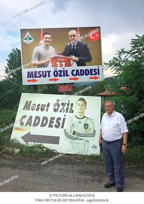24 July 2018, Turkey, Devrek: The controversial photo of Mesut Ozil and Turkish President Erdogan is now displayed in large format on the sign in Devrek...