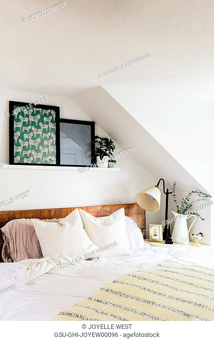 Bed with White Linens and Colorful Artwork