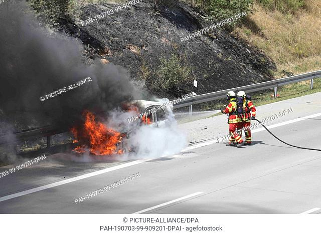 Fire on highway Stock Photos and Images | age fotostock
