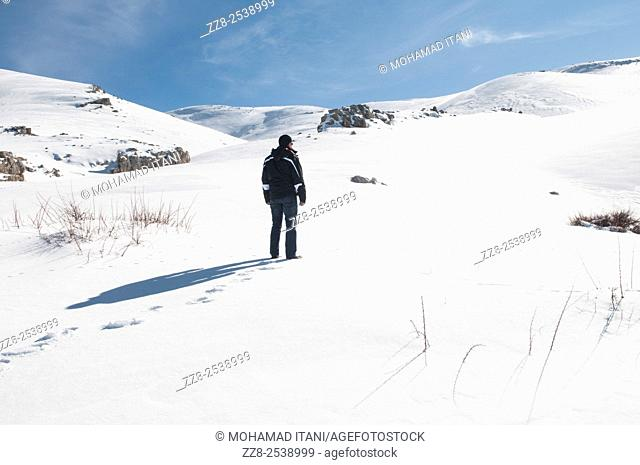 Man standing in the snow Faraya Lebanon