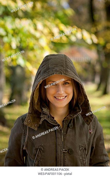 Germany, Rhineland-Palatinate, Female student wearing hood, smiling