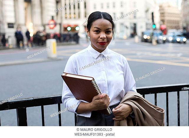UK, London, portrait of smiling businesswoman