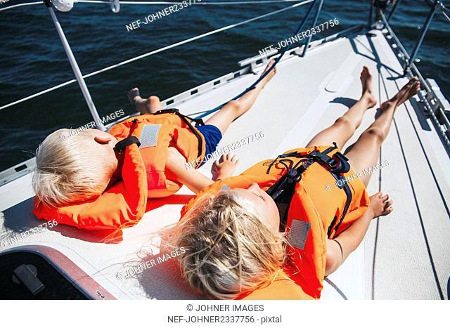 Children relaxing on boat