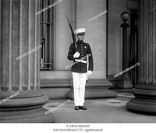 U.S. Marine Standing Guard at U.S. Treasury During Ku Klux Klan Parade, Washington DC, USA, 1925