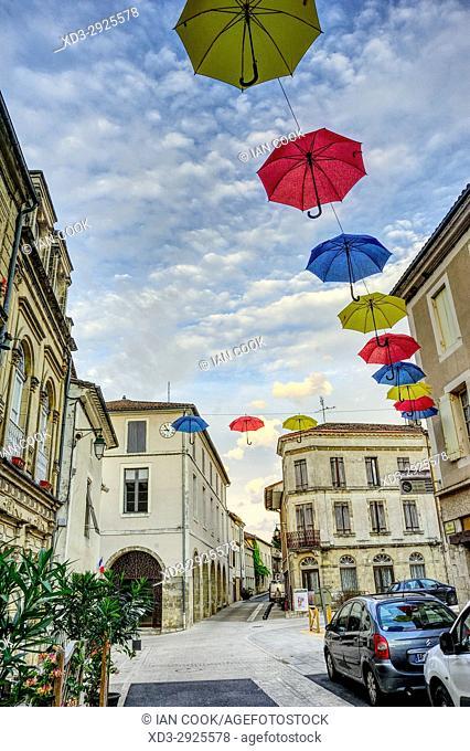 Rue Marcel Herve decorated for annual Gasconnade Festival, Lauzun, Lot-et-Garonne Department, New Aquitaine, France