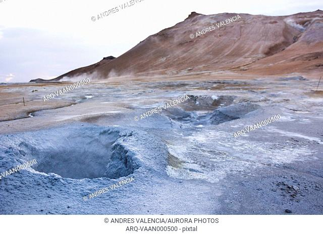 A series of boiling hot blue coloured mud puddles spit out steam, sulphur and other poisonous gases , which have coloured the soil around it blue and bright...