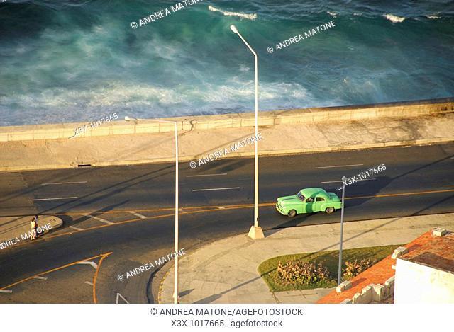 Aerial view of a green car in the El Malecon Havana skyline Cuba