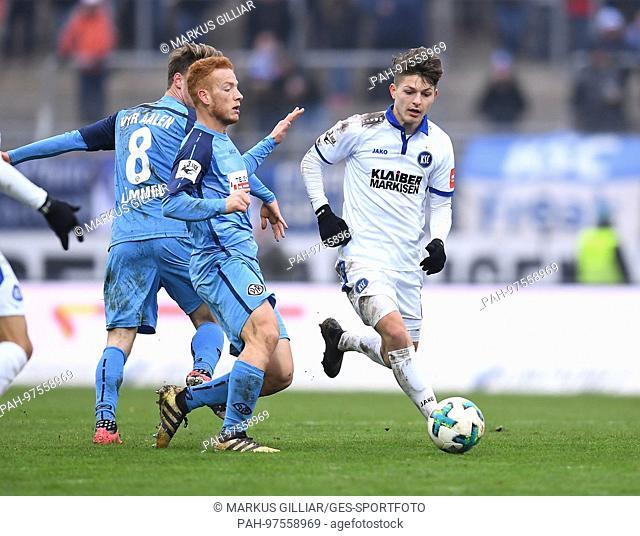 duels / Duell Florent Muslija (KSC) versus Sebastian Vasiliadis (Aalen). GES/ Fussball/ 3. Liga: Karlsruher SC - VfR Aalen, 02.12