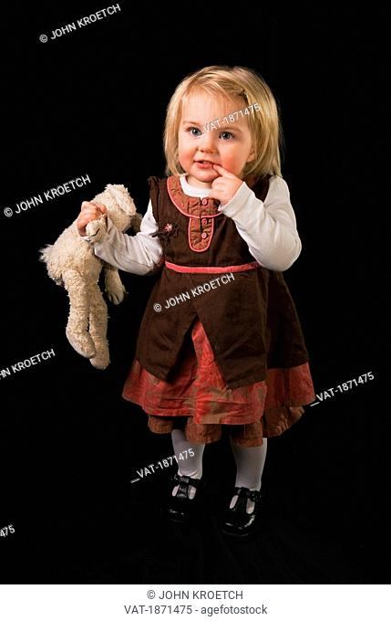 A Young Girl With Her Stuff Toy